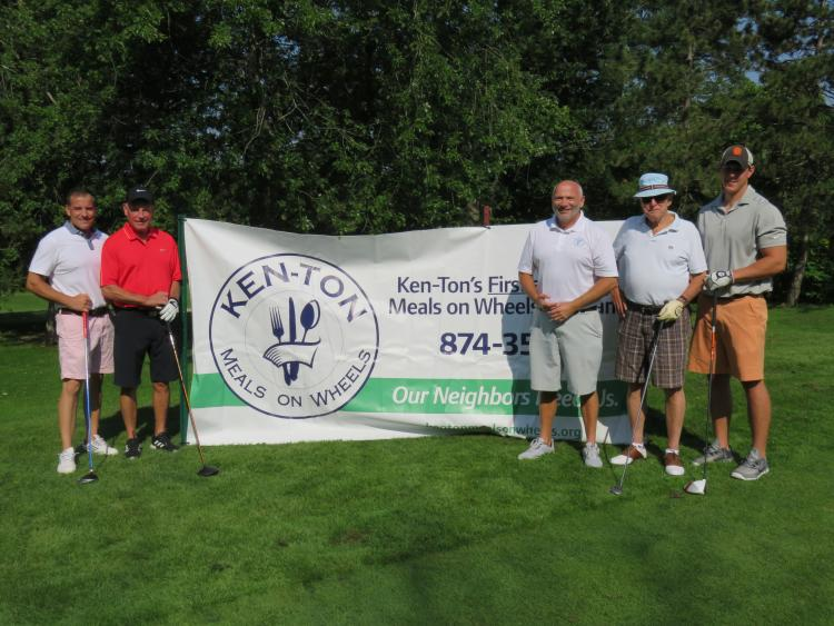 Ken-Ton Meals on wheels banner with golfers from the 2017 golf tournament.