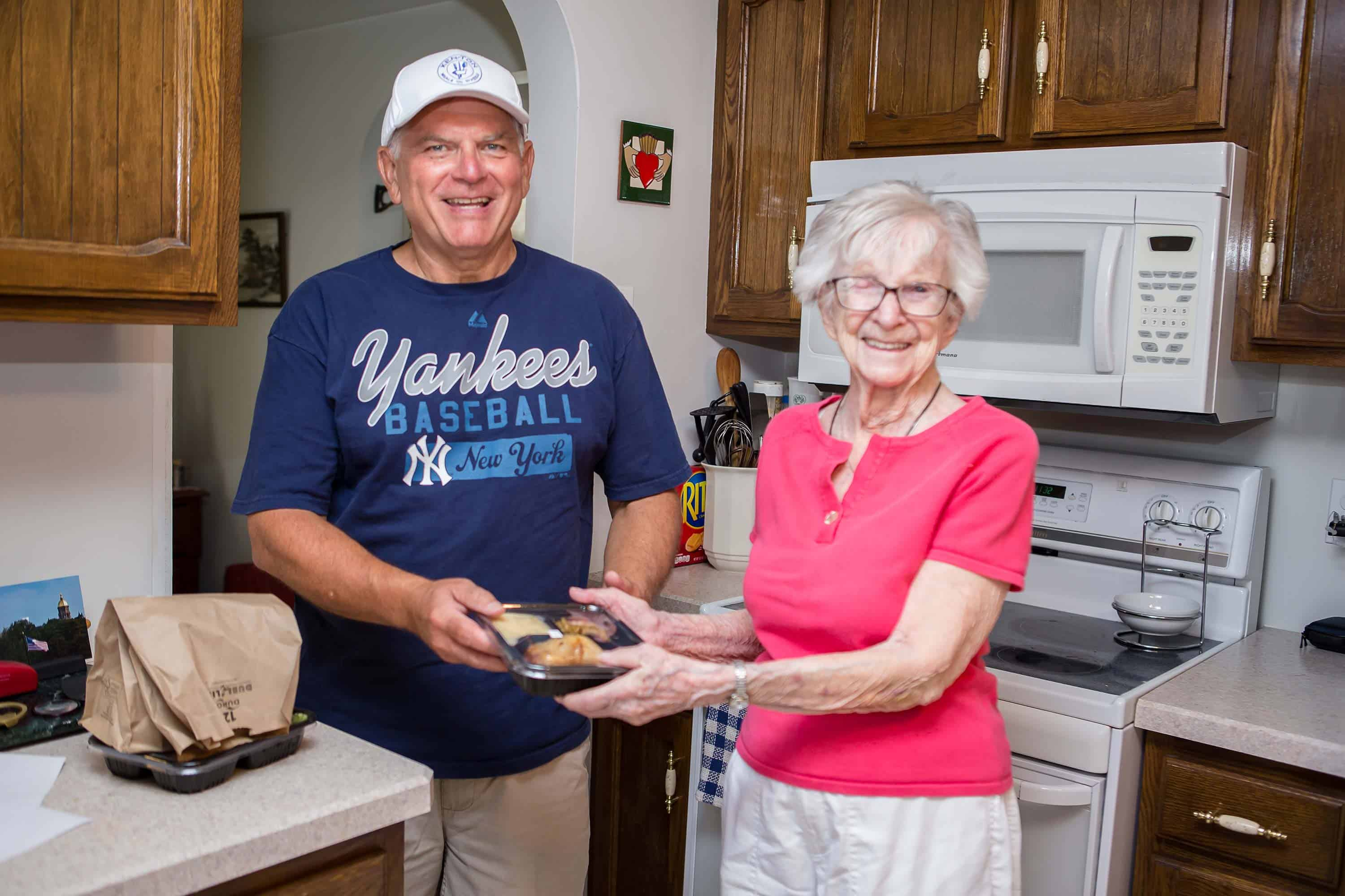 Ken Ton Meals on Wheels Volunteer Delivering Food to Resident